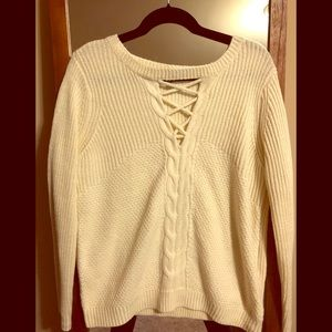 Cream cable knit sweater with crisscross detail
